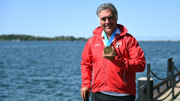 Francisco Boza of Peru poses with his gold of Shooting final at the 2015 Pan American Games in Toronto, Canada, on July 16, 2015. AFP PHOTO/HECTOR RETAMAL